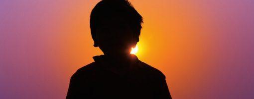 sunset lone boy-1097625_640