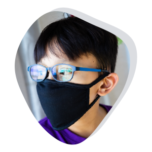 Boy with glasses wearing face mask